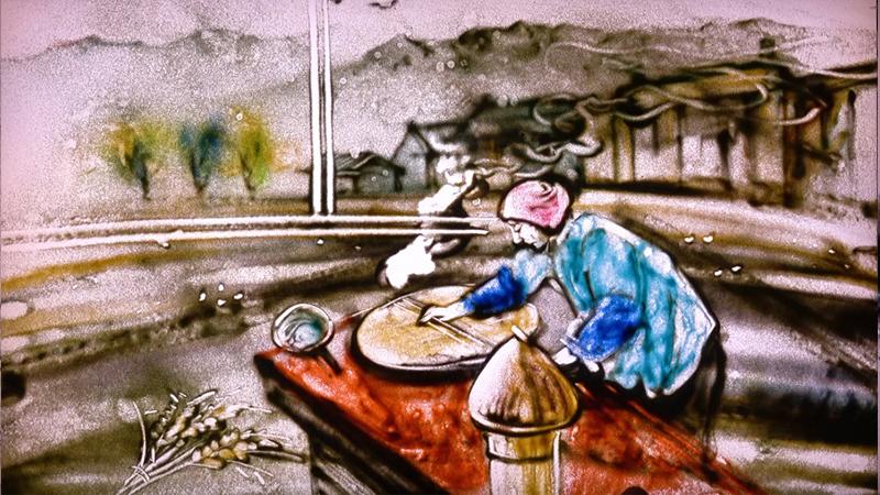 沙畫見證稻米的一生